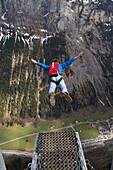 Man skydiving in rural landscape