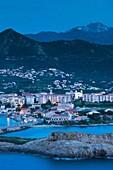 France, Corsica, Haute-Corse Department, La Balagne Region, Ile Rousse, city view from Ile de la Pietra, dusk