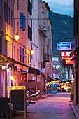 France, Corsica, Haute-Corse Department, La Balagne Region, Ile Rousse, outdoor cafes, dusk, NR