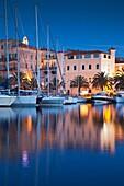 France, Corsica, Corse-du-Sud Department, Corsica South Coast Region, Propriano, town marina, dusk