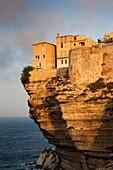 France, Corsica, Corse-du-Sud Department, Corsica South Coast Region, Bonifacio, cliffside houses, dawn