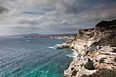 France, Corsica, Corse-du-Sud Department, Corsica South Coast Region, Bonifacio, Circuit des Falaises, cliff walk, elevated view of city and cliffs