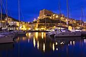 France, Corsica, Corse-du-Sud Department, Corsica South Coast Region, Bonifacio, port and Citadel, dusk