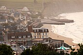 France, Normandy Region, Calvados Department, D-Day Beaches Area, Arromanches les Bains, elevated town view, dusk