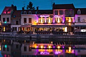 France, Picardy Region, Somme Department, Amiens, Quartier St-Leu, restaurants along the Somme River, dusk