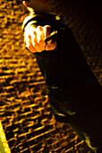 Man Pointing Gun in Dark