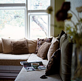 Living Room Interior with Cup of Tea and Magazine