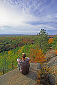 Hiker Sitting at Lookout Trail, Algonquin Park, Ontario