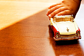 Detail of Child Holding Toy Car
