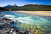 Medicine Lake and fast flowing waters from Maligne River, Jasper National Park, Alberta