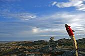 Woman Leaning onto a Strong Wind, Bauld's Hill, near Cape Bauld, Newfoundland