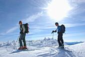 Two men skiing at Needle Peak, Cascade Mountains, Coquihalla Summit, British Columbia