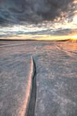 Setting sun on the ice of Teslin Lake, Yukon