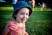 Young girl with blue denim hat and a big smile, Otterburn park, Quebec