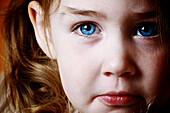 Close up of young girl with blue eyes, Otterburn, Quebec