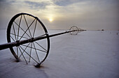 Irrigation equipment resting in the snow, Alberta