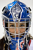 Close up of a teenage girl in Hockey Helmet