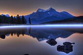 Sunrise on a Foggy Maligne Lake in Jasper National Park, Alberta