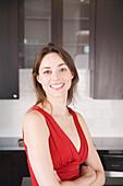 Woman Smiling in Kitchen, Toronto, Ontario
