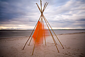 Tepee cover blowing in wind, Grand Beach, Manitoba