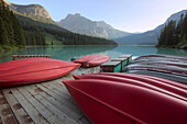 Red canoes on a dock, Emerald Lake, Yoho National Park, British Columbia