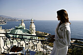 Principality of Monaco, Monte Carlo, Société des Bains de Mer - a publicly traded company with interests in gambling, entertainment, accommodation..., Hermitage Hotel, Thermal Bath, woman wearing a bathrobe and holding a cup of coffee