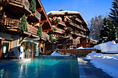 France, Rhone Alps, Megève Ski Resort, Chalet du Mont d'Arbois - Relais & Châteaux luxury hotel, view from the swimming pool