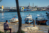 Republic of Turkey, Istanbul, Karaköy District, The New Mosque and the Galata Bridge, view from the edge of the Bosphorus