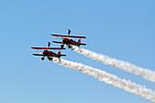 France, Essonne, La Ferte Alais, Airshow 2012. Wing Walkers on Stearman aircraft in full aerobatics.
