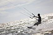 France, Normandy, Manche, Hauteville sur Mer, man doing kitesurfing