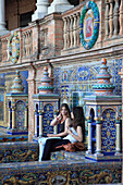 Spain, Andalusia, Seville, Plaza de Espana, azulejo, ceramic tile images, people