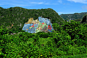 The Mural de la Prehistoria painted in 1961 by Leovigildo Gonzalez in Vinales Valley, Cuba