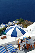 Greece, Aegean Sea, Santorini - Thera, Oia, View from above of the terrace of a private villa in front of the Nea Kameni volcano