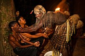 Africa, Gabon, Mboka A Nzambe village, Bwiti ceremonies, Forest, the shaman Adumangana makes a healing ritual to establish communication between a mother and her child