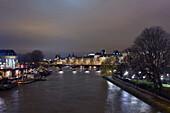 France, Paris, Seine at night, the western tip of Ile de la Cité beside Square du Vert Galant. In the back ground : Passerelle des Arts et Louvre.
