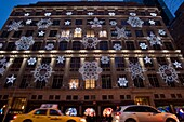 GIANT SNOW FLAKES CHRISTMAS SAKS DEPARTMENT STORE LIGHT DISPLAY FIFTH AVENUE MANHATTAN NEW YORK CITY USA