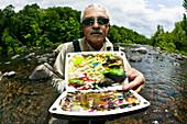 Fisherman Holding Up Various Lures, Agawam Massachusetts Usa