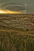Lightning strike over badlands national park, south dakota usa
