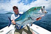 Man holding a jack fish, panama