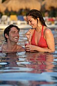 Young Couple Drinking Cocktails In Swimming Pool, Mayan Riviera,Yucatan Peninsular,Quintana Roo State,Mexico