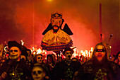 Bonfire Societies Marching Through The Streets Of Seaford With Effigy Of Alfred The Great, East Sussex, Uk