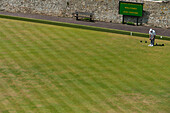 Man Playing Lawn Bowling In Lewes, East Sussex, Uk