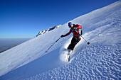 Backcountry skier downhill skiing, Monte Prena, Gran Sasso, Abruzzo, Italy