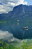 People rowing over lake Altausseer with view to Trisselwand, Totes Gebirge range, Salzkammergut, Styria, Austria
