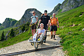 Group of hikers accompanying man in wheel chair, mountaineering with handicapped people, Rotwand, Spitzing, Bavarian Alps, Upper Bavaria, Bavaria, Germany