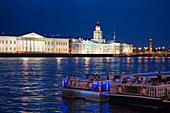 Sightseeing excursion boats on the Neva river with Kunstkamera Museum during white nights, St. Petersburg, Russia, Europe