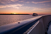 Deck railing of river cruise ship MS General Lavrinenkov (Orthodox Cruise Company) at sunset, Svir river, Lake Onega, Russia, Europe