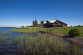 Lake shore, Belfry, Church of the Transfiguration and Church of the Intercession of the Virgin at Kizhi Pogost, Kizhi Island, Lake Onega, Russia, Europe