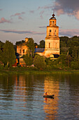Fishing boat and church tower along the ´river, near Yaroslavl, Russia, Europe