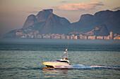 Pleasure boat near the Ipanema coastline at dawn, Rio de Janeiro, Rio de Janeiro, Brazil